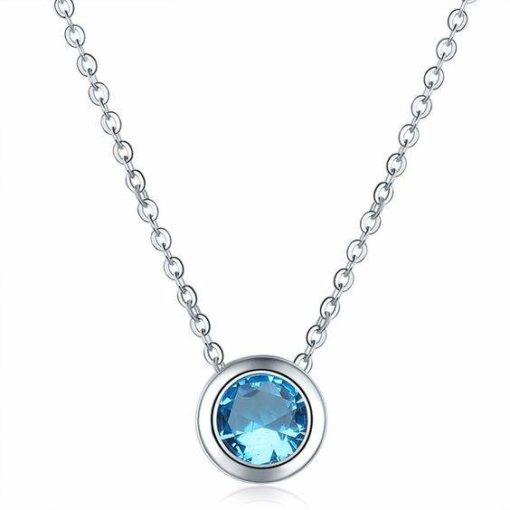 Collier oxyde de zirconium bleu plaque argent.